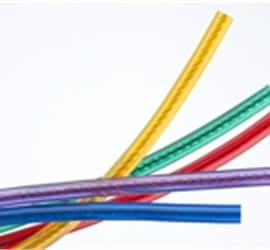 view of multiple custom audio cables in different colours.